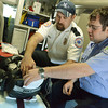 Globe/Roger Nomer<br /> Newton County Paramedic Levi Clymer, left, gives James Kelleher, a Crowder paramedic student from Ireland, instruction on an ECG Monitor at Newton County Ambulance Station One on Thursday.