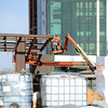 Construction of a metal canopy for the emergency entrance continues Thursday on the south side of the new Mercy Hospital 100-acre campus. <br /> Globe | Laurie Sisk