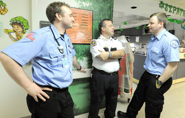 Crowder College EMS Clinical Supervisor and Paramedic Instructor Ike Isenhower, center, chats with international paramedic students Ian Kearney, left and Andy O'Connell, both of Dublin, Ireland on Wednesday at Freeman West Hospital.<br /> Globe | Laurie Sisk