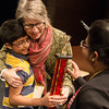 Globe/Roger Nomer<br /> Shrihari Nagarajan, a fourth grader at Thomas Jefferson Independent Day School, gets a hug from Mary Arnold, one of the teachers from his school who helped him prepare for the bee, following his first-place finish on Monday.