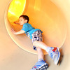 Five-year-old Jesse James enjoys a trip down a slide on Thursday at Parr Hill Park.<br /> Globe | Laurie Sisk