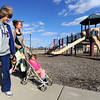 Donna Craig, left and Mikaila Adame take Adame's two-year-old daughter, Alaina Adame for a stroll through Parr Hill Park on Wednesday.<br /> Globe | Laurie Sisk