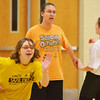 Globe/Roger Nomer<br /> (from left) Makayla Slawter, 17, Azalea Ray, 15, and LaShayla Gillespie, 18, run through a drill during practice for the Special Olympics basketball team on Tuesday at Neosho Junior High School.