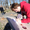 Seventeen-year-old Drew Cox logs his Joplin High School Key Club team's progress as they participate in the  Amazing Weed Whacker Challenge on Saturday at Wildcat Glades Park. The event served as both clean-up of the grounds and an educational scavenger hunt.<br /> Globe | Laurie Sisk