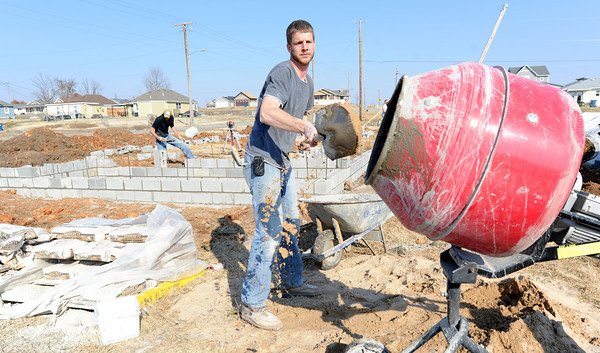 Gene Isaac, Alberta, Canada, mixes cement for the foundation of a new four bedroom home at 2401 South Murphy on Thursday. Isaac is a Christian Public Service volunteer working in conjunction with Rebuild Joplin.<br /> Globe | Laurie Sisk