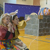 Globe/Roger Nomer<br /> Elizabeth Fischborn, left, and Ashley Cutright lure Tim Petty into a well during a performance by the Tulsa Opera on Thursday at St. Mary's Elementary.