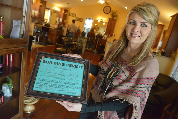 Globe/Roger Nomer<br /> Diana Collins shows the first building permit following the 2011 tornado for Cut Loose.