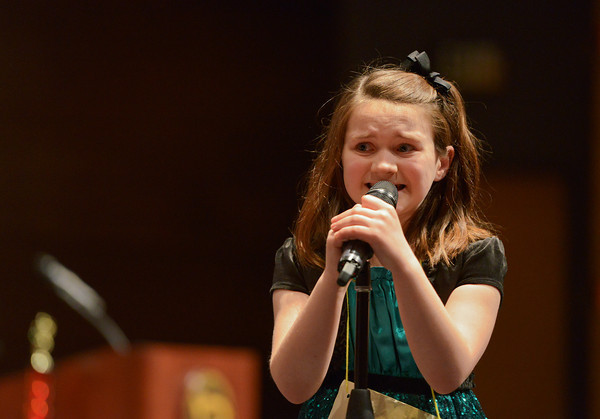 Globe/Roger Nomer<br /> Sadie Brock, a fourth grader at Fairview Elementary, guesses at the spelling of a word during the annual Joplin Globe Spelling Bee at Thomas Jefferson Independent Day School on Monday. Brock's guess paid off, and she successfully spelled the word.