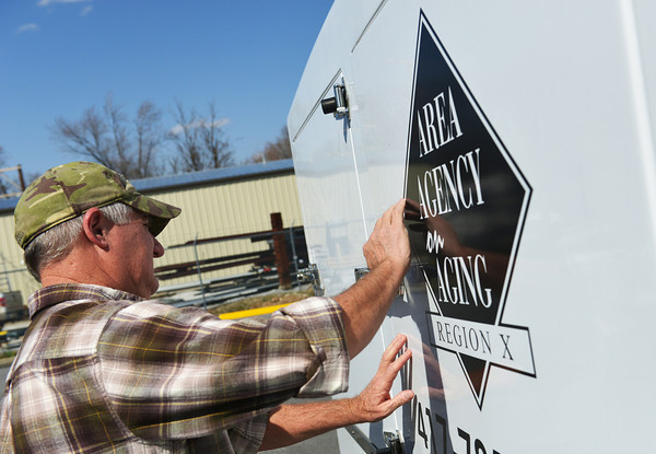 Globe/Roger Nomer<br /> Rick Silvers, a frozen meal delivery driver with the Area Agency on Aging, closes the door on a truck provided for by tornado funds.