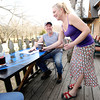 River's Bend employee Rei Alexander serves Dennis Robbins a drink on the deck of the bar and grill on Tuesday night.<br /> Globe | Laurie Sisk
