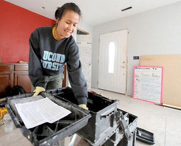 Uniiversity of Connecticut nursing student Thea Vo assists in the clean up of tools while working on a house at 2018 Annie Baxter on Wednesday. Vo is one of about 20 Connecticut students spending their Spring Break helping Rebuild Joplin. Globe | Laurie Sisk