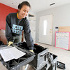 Uniiversity of Connecticut nursing student Thea Vo assists in the clean up of tools while working on a house at 2018 Annie Baxter on Wednesday. Vo is one of about 20 Connecticut students spending their Spring Break helping Rebuild Joplin.<br /> Globe | Laurie Sisk