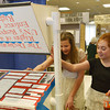 Globe/Roger Nomer<br /> Grace Nielson, left, and Phoebe Watson, seventh graders at Joplin North Middle School, check out a display at History Day at Missouri Southern on Friday.
