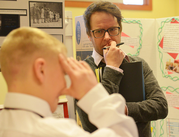 Globe/Roger Nomer<br /> Missouri State University graduate student and judge William Kimbrel listens as Braxton Barnes, a seventh grader at Neosho Middle School, pauses for an answer during History Day at Missouri Southern on Friday.