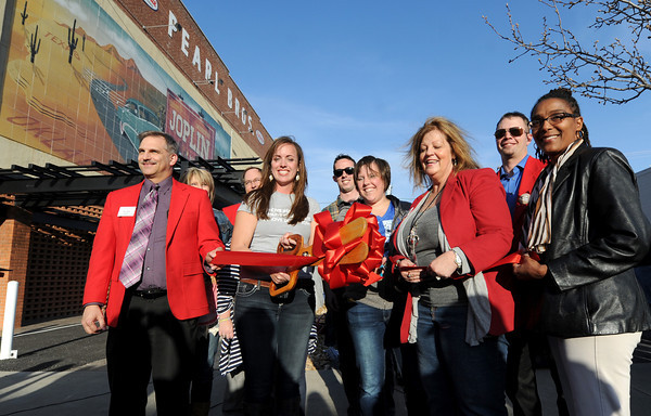 Members of the Joplin Chamber of Commerce participate in a ribbon cutting ceremony for the Route 66 Mural Park as part of Third Thursday on Main Street.<br /> Globe | Laurie Sisk