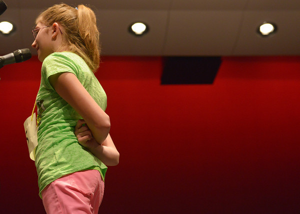 Globe/Roger Nomer<br /> Graci Millard, a fourth grader from Columbia Elementary, twists her arms behind her back as she spells a word in Monday's spelling bee.