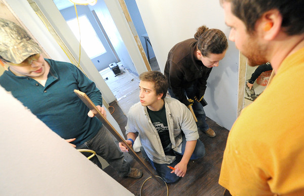 From the left: University of Connecticut students Peter Larson, Rob Neubauer, Jane Moran and T.J. Green install laminate wood floors in a house at 2018 Annie Baxter on Wednesday. The four are part of a group of about 20 Connecticut students spending their Spring Break helping Rebuild Joplin.<br /> Globe | Laurie Sisk