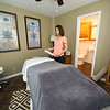 Enlight Inn owner Christa Tullis stands in a massage room at the inn on Wednesday.<br /> Globe | Laurie Sisk