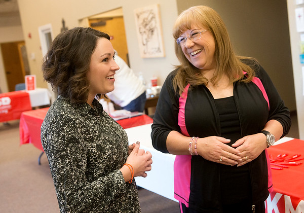 Globe/Roger Nomer<br /> Sara Massey, left, talks with Marilyn Daniel, Neosho, on Friday during a bone marrow screening event at First Baptist Church in Neosho. Massey's mother Jane was the inspiration for the screening event.