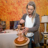 Joplin artist April Davis-Brunner paints a sculpture she created using a low-fire clay during the First Thursday Art Walk on Thursday night at The Bistro Event Center. The event was the kick-off for the 2017 Art Walk season.<br /> Globe | Laurie Sisk