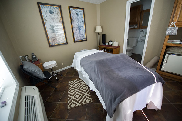 A massage room is one of many options for rejuvenation and relaxation at the Enlight Inn. The inn also features a massage chair, an infrared sauna, a cafe and therapeutic incline bedrooms.<br /> Globe | Laurie Sisk
