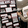Globe/Roger Nomer<br /> Aleacia Bahler, a homeschooled junior from Joplin, puts the finishing touches on her presentation on the Holocaust on Friday during History Day at Missouri Southern.