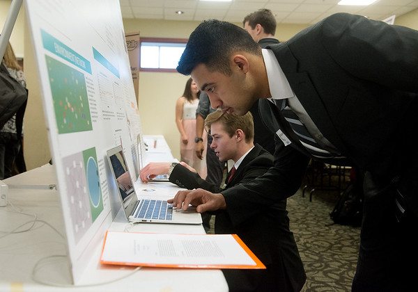 Globe/Roger Nomer<br /> Hamza Kamran, above, and Sam Griesemer, both Joplin High seniors, prepare their projects on Tuesday at the Science Fair at Missouri Southern.