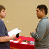 Globe/Roger Nomer<br /> Thomas Ayres, a junior at Carl Junction High School, talks with Manuel Mendoza, a Pittsburg State senior from Dodge City, Kan., about PSU's automotive technology program on Thursday during a job fair at Franklin Tech.