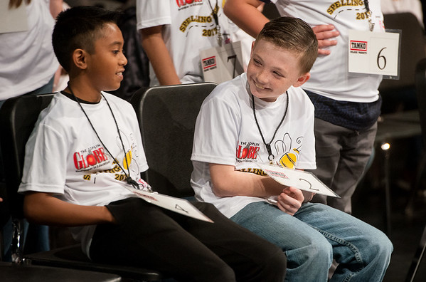 Globe/Roger Nomer<br /> Dylan Cook, right, a fourth grader at Alexander Elementary, congratulates Antwone Esiel, a fourth grader from Anderson Elementary, on advancing in Monday's Joplin Globe Spelling Bee at Thomas Jefferson Independent Day School.