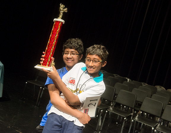 Globe/Roger Nomer<br /> Shrihari Nagarajan, 12, holds up his younger brother Prithvi Nagarajan for a photo after Prithvi, a fifth grader at Thomas Jefferson Independent Day School, won The Joplin Globe Spelling Bee on Monday at Thomas Jefferson. Shrihari won the bee in 2014.