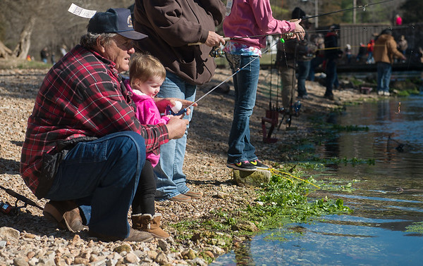 Globe/Roger Nomer<br /> Larry Periman, Verona, helps his great grandaughter Braelyn Periman, 2, fish on Wednesday during opening day at Roaring River State Park.