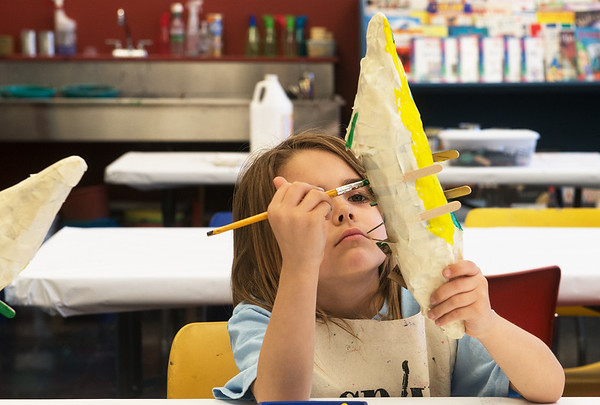 Globe/Roger Nomer<br /> Stella Beezley, 6, works on a water bottle crocodile on Monday at the Recycled Art Camp at Spiva Center for the Arts.