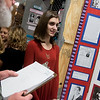 Globe/Roger Nomer<br /> Cora Burkhart, a seventh grader at Carl Junction, talks with judges about her project on Amelia Earhart on Friday during History Day at Missouri Southern.