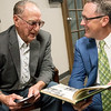 Globe/Roger Nomer<br /> Charlie Bridges, Diamond, shows his 1960 Joplin Junior College yearbook to Kevin Greim, associate vice president for development at Missouri Southern, on Friday for the Joplin Junior College reunion at the Memorial Education Center.