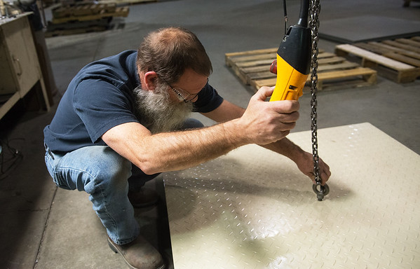 Globe/Roger Nomer<br /> James House, scales assembler, works with a pallet floor scale on Tuesday at Cardinal Scales.