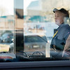 Globe/Roger Nomer<br /> A Waffle House employee watches the response to Wednesday's shooting from her restaurant window.