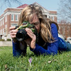 Globe/Roger Nomer<br /> Koral Martin takes a photo of flowers on Wednesday at Central Park in Carthage.