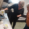 Globe/Roger Nomer<br /> Carolyn Young, associate professor with the Noble Foundation, shows Steve Sater, Mt. Vernon, an image of endophytes in Fescue during a seminar at the University of Missouri Southwest Center on Tuesday.