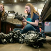 Globe/Roger Nomer<br /> Hannah Bagley, left, and Annie Secker, sophomores at College Heights, sort stuffed toys on Monday at Rapha House.