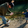 Globe/Roger Nomer<br /> Ty Larin, Joplin, helps his son Jake Trenary, 3, bait his hook on Wednesday during opening day at Roaring River State Park.
