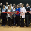 Globe/Roger Nomer<br /> Rhonda Gorham, executive director of the Boys and Girls Club of Southwest Missouri, cuts the ribbon to commemorate the 60th birthday of the club on Friday. The Boys and Girls Club of Southwest Missouri celebrates its birthday in April.
