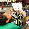 "Kobe Hayes reads a copy of Wall E's ""Love at First Beep"" during a school-wide read-in on Friday morning in Diana Younker's first grade class at Stapleton Elementary.<br /> Globe 