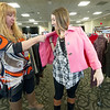 Boys and Girls Club of Southwest Missouri Executive Director Rhonda Gorham, left, assists Missouri Southern sophomore Jayse Henderson with a blazer choice during the Dress to Impress event on Thursday at MSSU.<br /> Globe | Laurie Sisk
