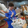 Globe/Roger Nomer<br /> Laura Stantz, Spencer, Ind., works on a stuffed cactus while selling her crafts at the Hip Handmade Market on Saturday at The Roxy in Joplin. The entry fee for the market benefits Art Feeds Joplin.