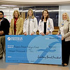 Photo Courtesy Freeman Health System<br /> (left to right) Dr. Talal Khan, Freeman Nephrologist; Paula F. Baker, Freeman President and Chief Executive Officer; Dr. Leslie Hamlett, Freeman Nephrologist; Dr. Aleta Greathouse, Freeman Nephrologist; Linda McIntosh, Freeman Program Manager of Volunteer Services, attend a check presentation from Freeman Auxiliary to the Freeman Patient Dialysis Fund for $15,000 on Tuesday at Freeman Hospital East. Freeman Nephrology & Dialysis Center and the Freeman Auxiliary are also sponsoring the March O' The Kidney at Northpark Mall on Saturday at 8:00 a.m., which is a walk to benefit the Freeman Patient Dialysis Fund.