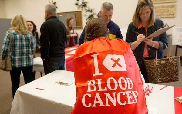 "Globe/Roger Nomer<br /> Mara Drimak, St. Louis, wears a ""I Delete Blood Cancer"" cape on Friday during a bone marrow screening event at First Baptist Church in Neosho."