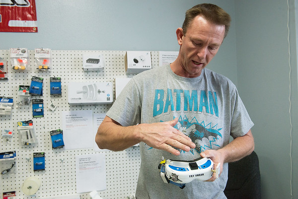 Globe/Roger Nomer<br /> Michael Jones, owner of Blue Sky Hobbies, talks about a pair of drone racing goggles on Friday.