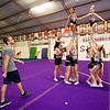 Sean Haase watches as his girls build a pyramid during practice at the Flip Shop Cheer Zone in Webb City  on March 16. In addition to coaching the girls, Haase also flies a medical helicopter.<br /> Globe | Laurie Sisk