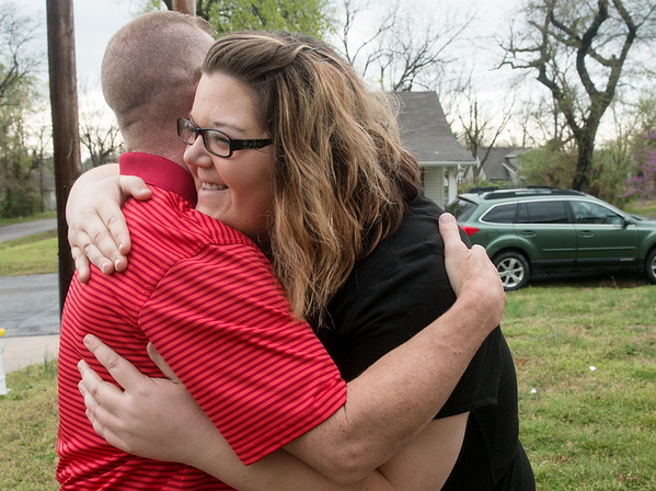 Globe/Roger Nomer<br /> Meri Toliver gets a hug from Mark Wear as they meet at her house in Joplin on Friday.