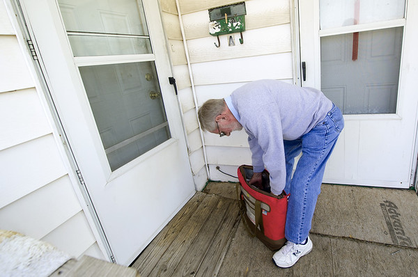 Meals on Wheels volunteer Mike Howard delivers a meal to a client on Thursday morning at his Joplin home. Howard has volunteered with the program for about 13 years.<br /> Globe | Laurie Sisk